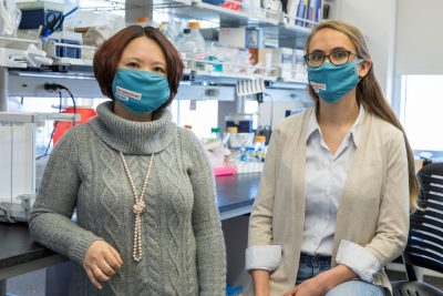 Xin Luo, associate professor of immunology at the Virginia-Maryland College of Veterinary Medicine, and Brianna Swartwout, a doctoral candidate in the Translational Biology, Medicine, and Health Graduate Program