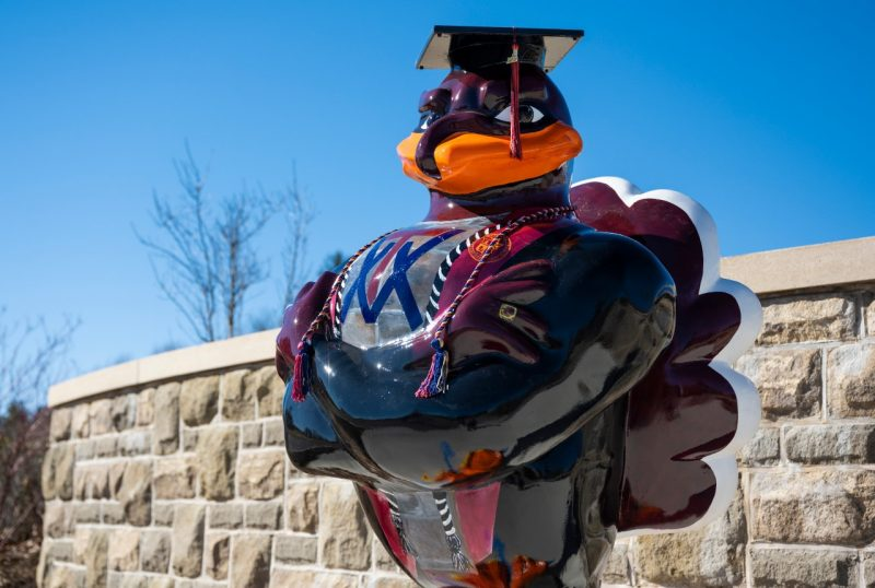 A new Hokiebird statue honoring the Class of  2020  stands at the sidewalk leading from the Visitor and Undergraduate Admissions Center to the Inn at Virginia Tech and Holtzman Alumni Center. Photo by Ryan Young.